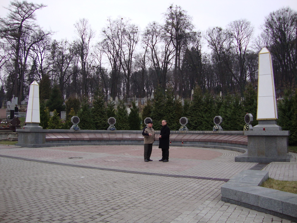Volodimir and a friend chatting at the Lychakiv Cemetery in Lviv, Ukraine