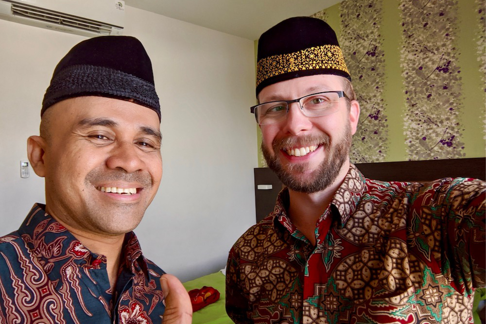 Me with my host, Dr. Halikuddin Umasangaji, in traditional Indonesia batik