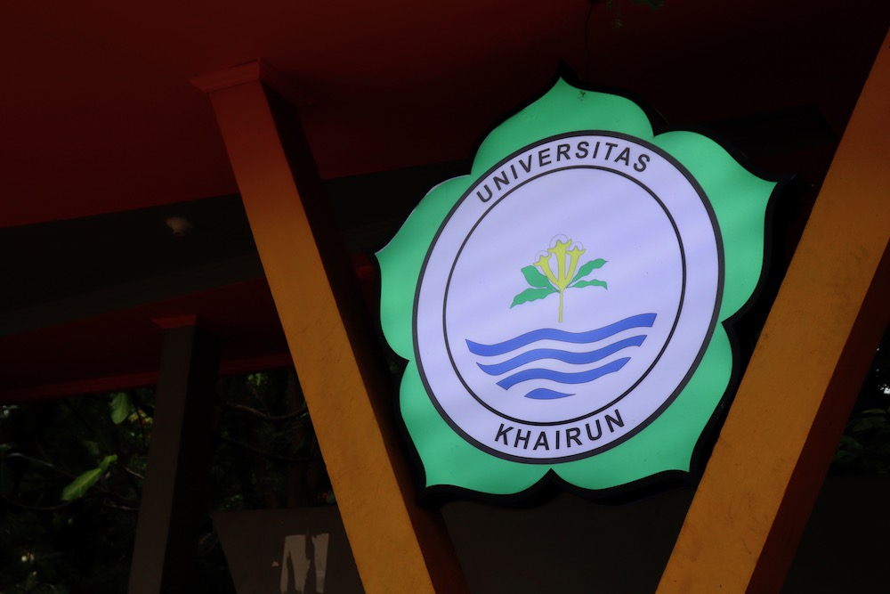 Khairun University logo, which is a green five-petaled flower with the university name and water inside